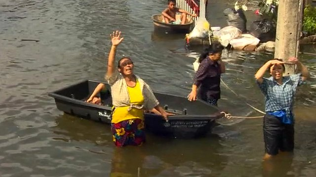 A Thai woman calls for help in a flooded part of Bangkok