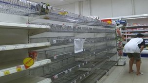 Empty shelves in a Bangkok supermarket. Photo by Andrew Batt