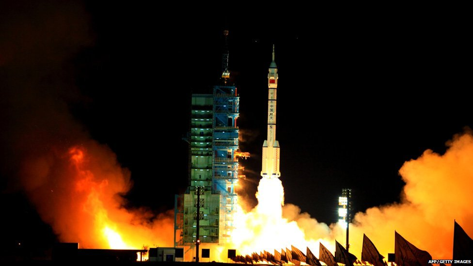 China's Long March-2F/H rocket carrying the unmanned spacecraft Shenzhou-VIII blasts off