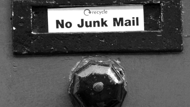Door with a 'no junk mail' sticker on it.