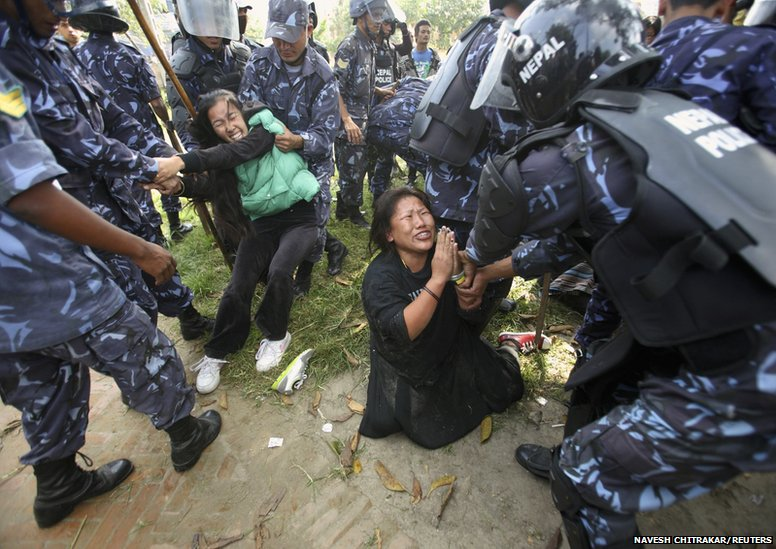 Nepalese police arrest Tibetan women during a protest in Kathmandu, 1 November 2011