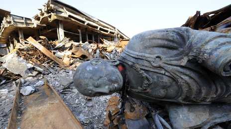 A Buddhist statue lies on the ground at the quake-hit Koganji temple in Iwate prefecture on 18 April 2011