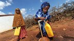 Children fetching water in the Somali village of Darussalam