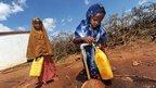 Children fetching water in the Somali village of Darussalam