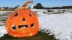 Halloween lantern in snow