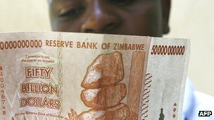 Zimbabwean looks at a new 50 billion dollar bank note issued by Zimbabwe's central bank in January 2009.