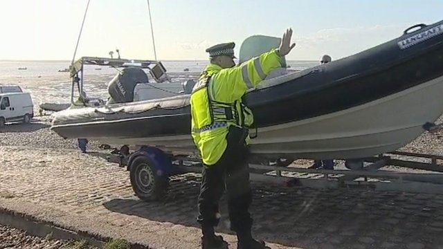 Police officer by boat