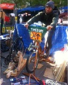 Occupy Wall Street protester Chris on a bike-operated generator