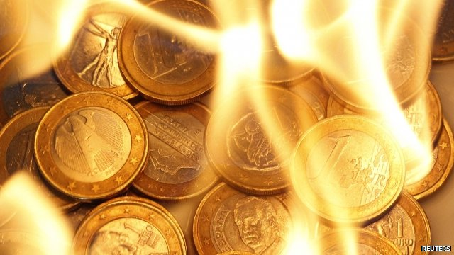 Euro coins on fire