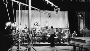 An orchestra is used to test thehe Marconi-EMI system