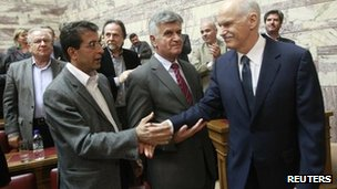 Greek Prime Minister George Papandreou (right) shakes hands with MPs after announcing his referendum plan, 31 October