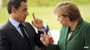 Photo taken on July 20, 2011 at the Chancellery in Berlin showing German Chancellor Angela Merkel and French President Nicolas Sarkozy
