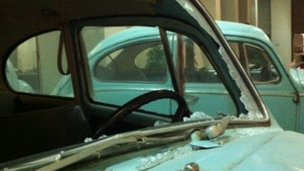 Colonel Gaddafi's damaged VW Beetle