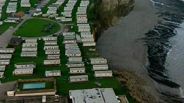 Caravans on a cliff edge at Porthkerry Leisure Park at Rhoose, near Barry