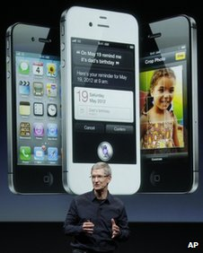 Apple chief executive Tim Cook promotes the iPhone 4S
