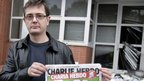 Charlie Hebdo's publisher, known as Charb, with a special edition of the magazine (2 November 2011)