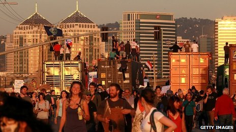 Protesters stand on trucks at the port of Oakland on 2 November 2011