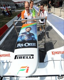 The Force India front wing is adorned with a poster of Indian Bollywood star Shah Rukh Khan