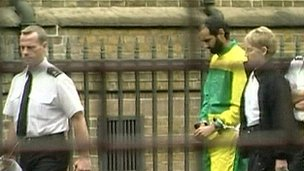 Babar Ahmad being led into court 
