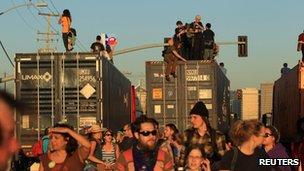 Protesters climb on trucks near the port of Oakland