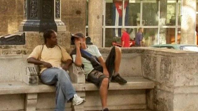 Cubans sitting on park bench
