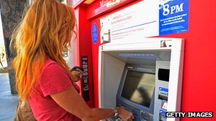 A woman uses a Bank of America cash machine