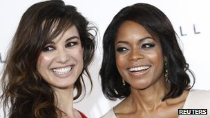 "Actors Berenice Marlohe (L) and Naomie Harris pose while launching the start of production of the new James Bond film ""SkyFall"" at"