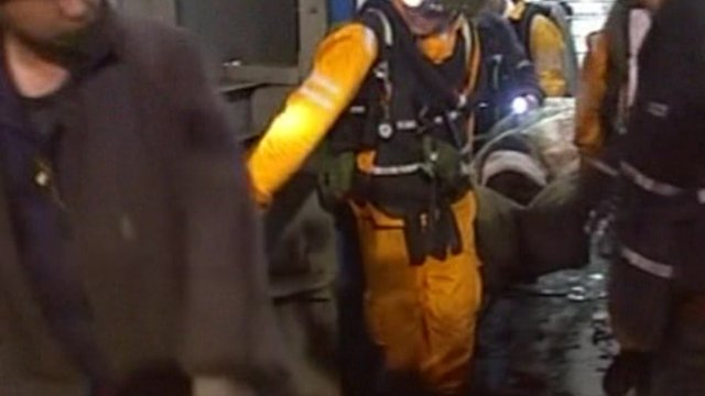 Man rescuing Chinese miner