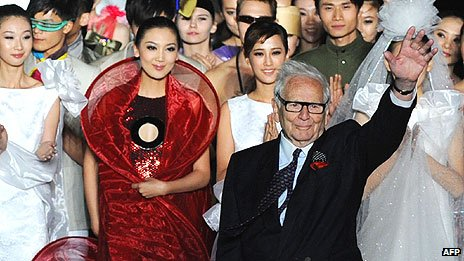 Pierre Cardin waves after his fashion show in May 2011