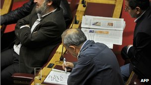 Communist party deputies during debate in Greek parliament. 4 Nov 2011