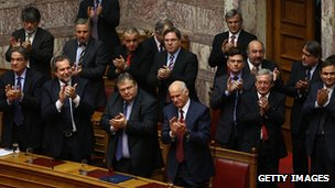 PM George Papandredou (first row, left) and members of his government applaud after winning the vote of confidence