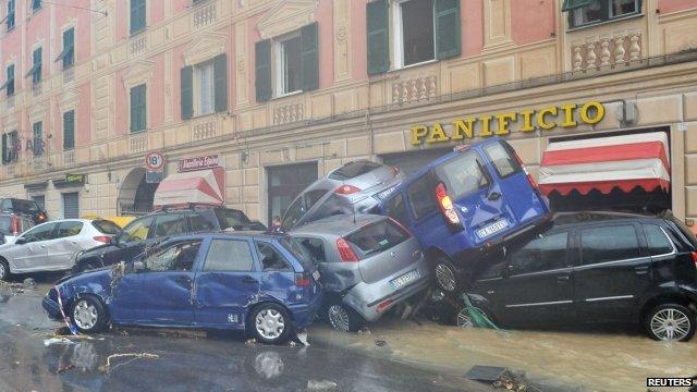 Cars piled high after flood