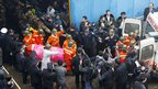 Chinese rescuers bring rescued miners out from the Qianqiu colliery in Yima, central China's Henan province on 5 November 2011