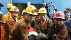 Rescue workers carry survivor out of Qianqiu colliery in Henan province - 5 November 2011
