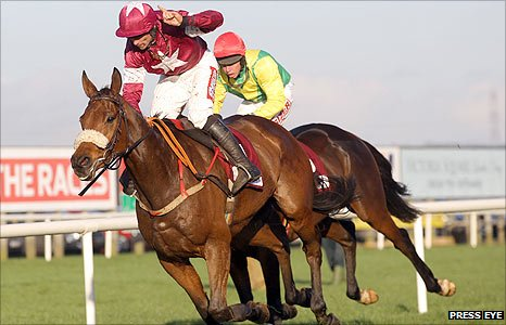 Davy Russell celebrates as Quito De La Roque beats Sizing Europe