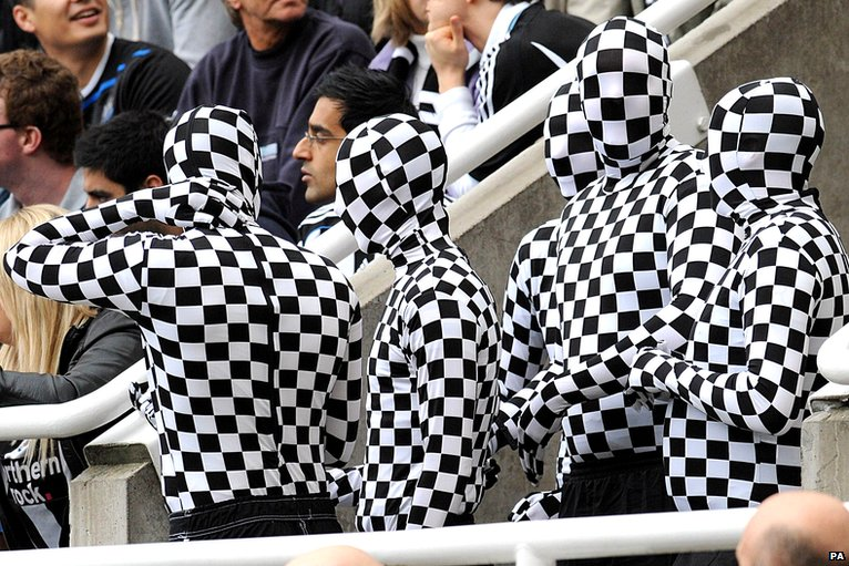 Newcastle United fans in morph suits