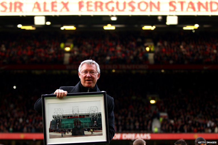 Manchester United's manager poses in front of the Sir Alex Ferguson Stand