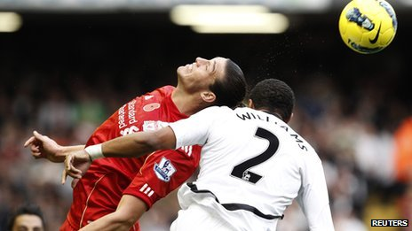 Andy Carroll challenges Ashley Williams for the ball