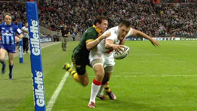 England's Ryan Hall goes over