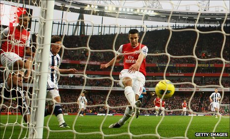 Robin van Persie grabs the opening goal at the Emirates