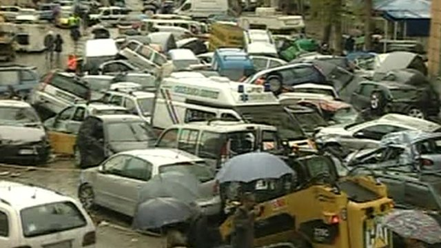 Cars crushed together after the flood