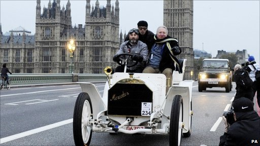 Former World Champion Nigel Mansell driving a 1902 Mercedes Tonneau with Mike Penning MP, over Westminster Bridge
