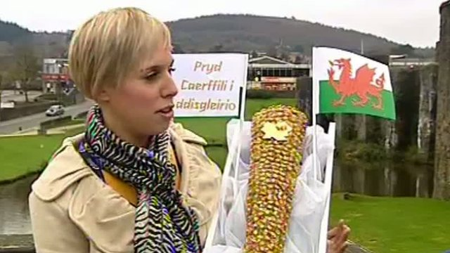 Louise Edwards from Caerphilly Castle shows a floral version of the Olympic torch