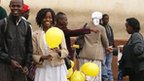 Commuters with yellow balloons in Nairobi, Kenya