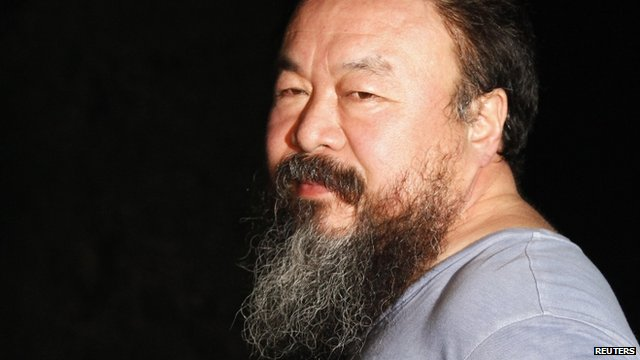 Dissident Chinese artist Ai Weiwei stands at the entrance of his studio after being released on bail in Beijing June 23, 2011
