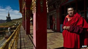 A young monk stands at Tibetan monastery in Sichuan province's Hongyuan county on 19 October 2011