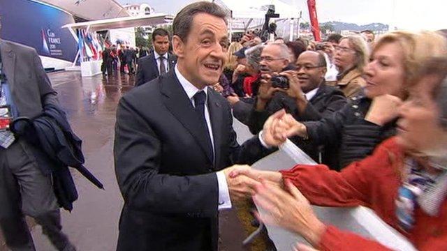 Nicolas Sarkozy shakes hands with crowds
