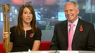 Midlands Today presenters Suzanne Virdee and Nick Owen with one of the Olympic torches