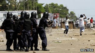 Opposition supporters confront riot police in Monrovia