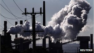 Vapour rise from a steel mill chimney in the industrial town of Port Kembla, about 80 km (50 miles) south of Sydney, in this file photo taken July 7